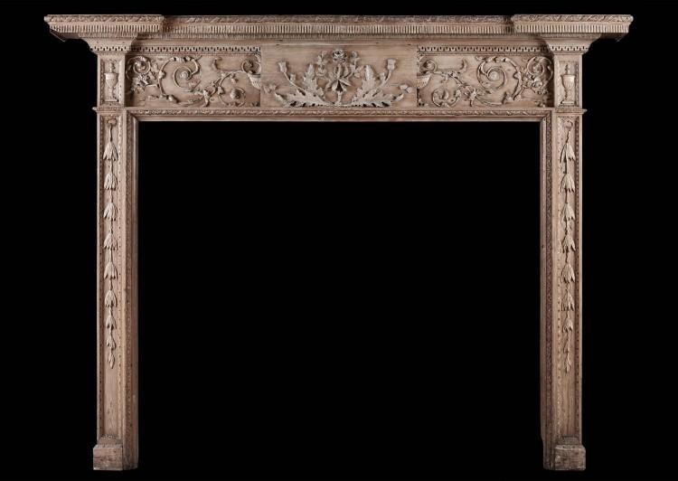 A fine quality 18th century carved pine fireplace