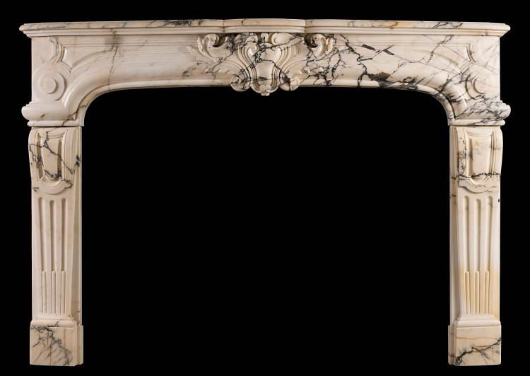 A 19th century Louis XIV / Louis XV style antique fireplace in Pavonazzo marble