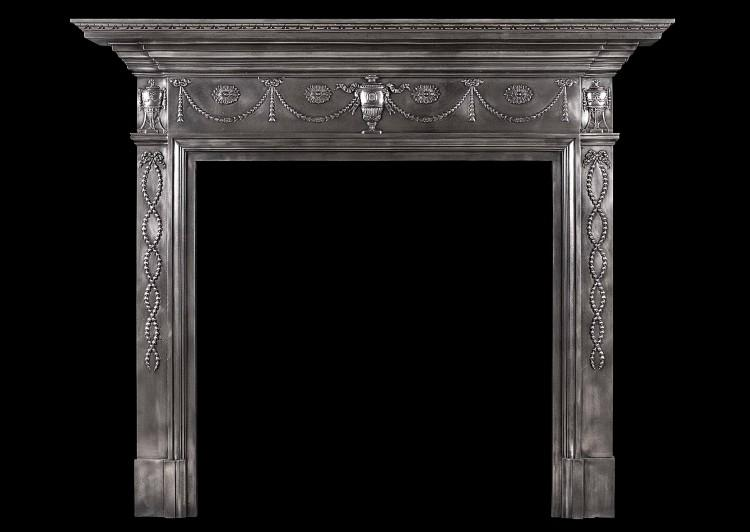 A 19th century polished cast iron fireplace in the Adam style