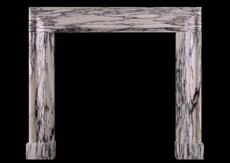 A moulded bolection fireplace in a veined marble