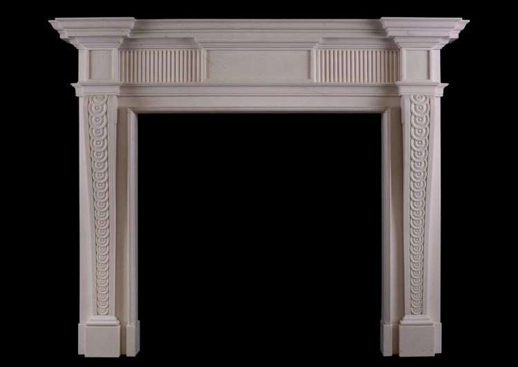 A George II style white marble fireplace