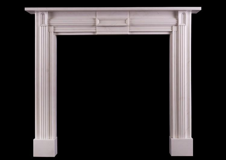 A white marble fireplace in the Soanian style