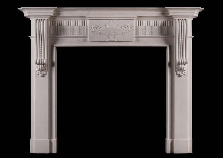 A Georgian style white marble fireplace with carved brackets