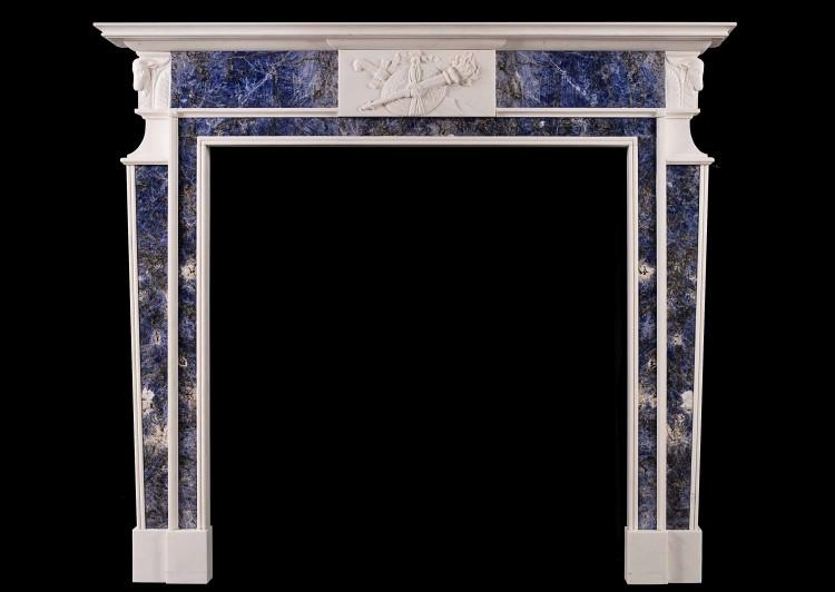 A late Georgian white marble fireplace with blue inlay