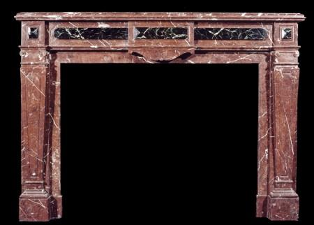 A FRENCH LOUIS XVI STYLE ROUGE ROYALE MARBLE FIREPLACE