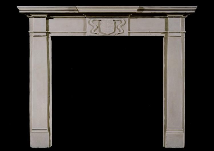 A 19th century English limestone fireplace
