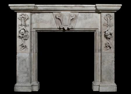 A LARGE 19TH CENTURY ENGLISH LIMESTONE FIREPLACE
