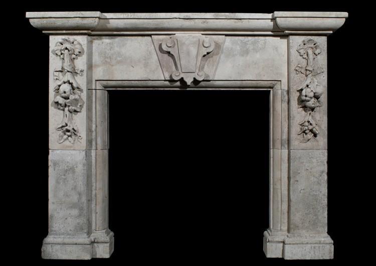 A large 19th century Italian limestone fireplace