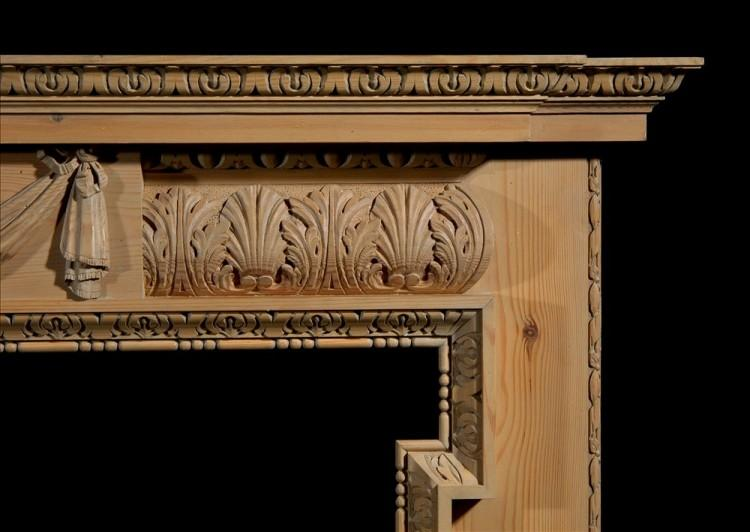 A CARVED PINE FIREPLACE WITH LION'S MASK AND DRAPERY-Detail2