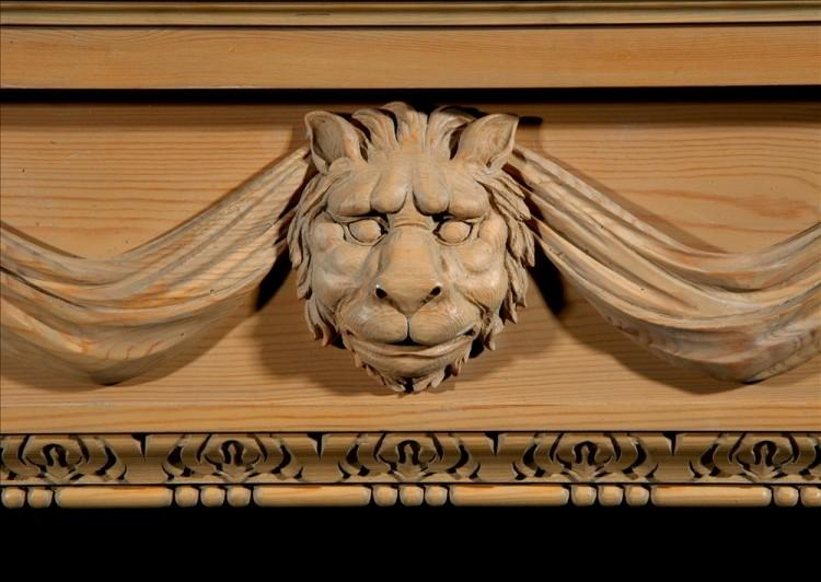 A CARVED PINE FIREPLACE WITH LION'S MASK AND DRAPERY-Detail3