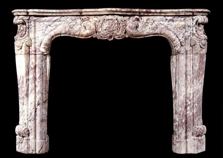 An 18th century French Louis XV Rose Boreal marble fireplace