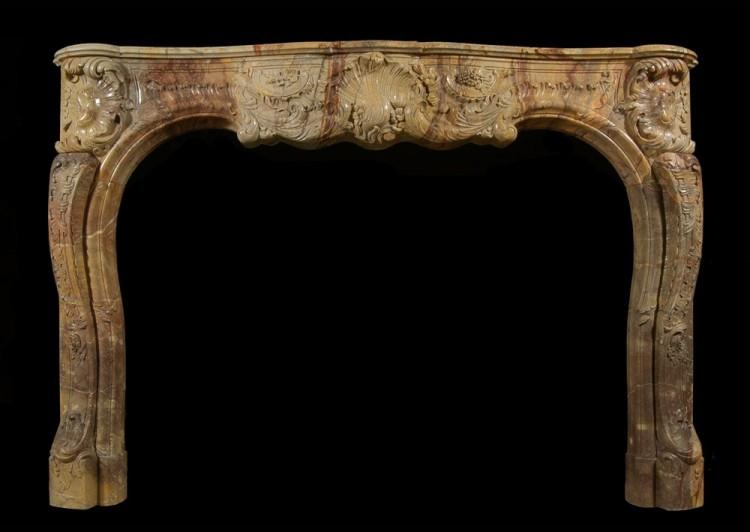 A superb quality French Louis XV style carved Sarrancolin marble fireplace