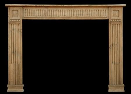A LATE 18TH CENTURY FRENCH LOUIS XVI PINE FIREPLACE