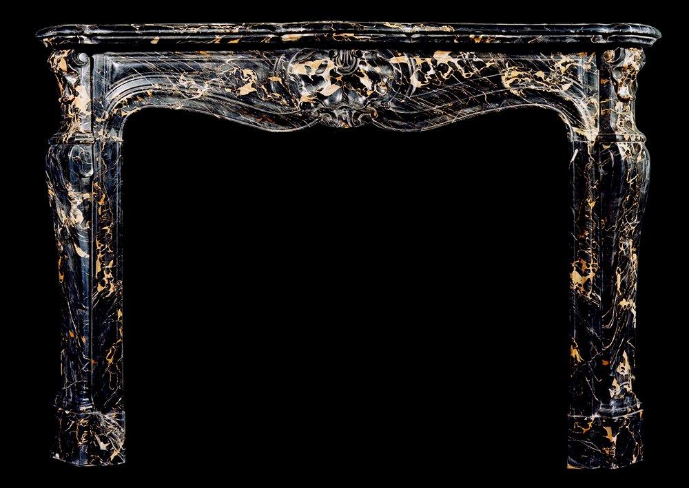 A 19TH CENTURY FRENCH LOUIS XV STYLE PORTORO MARBLE FIREPLACE