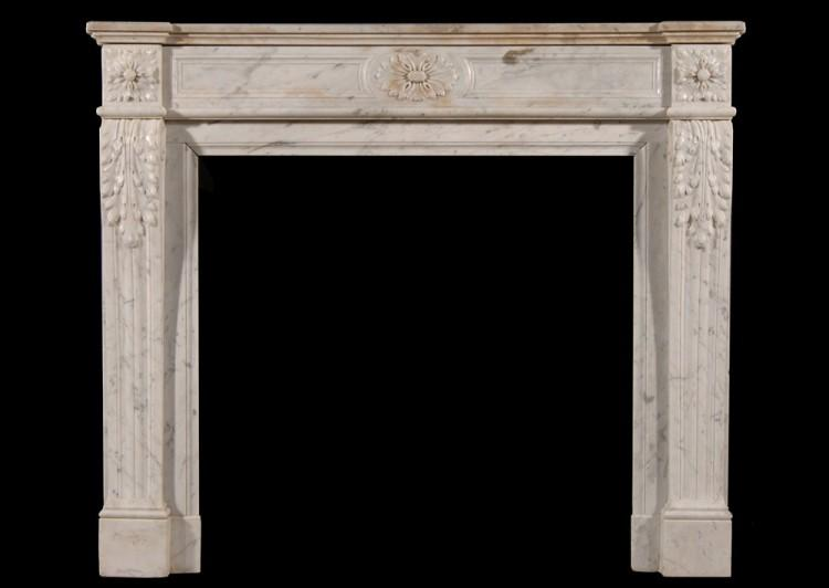 A Louis XVI style Carrara marble fireplace