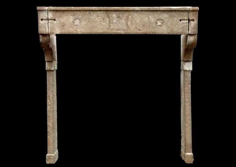 A large 18th century French Louis XVI stone fireplace