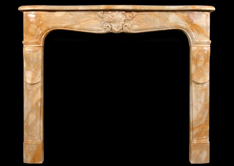 A 19th century Louis XV style Sienna marble fireplace