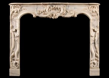 A FRENCH PROVENCALE STYLE ARABESCATO MARBLE FIREPLACE