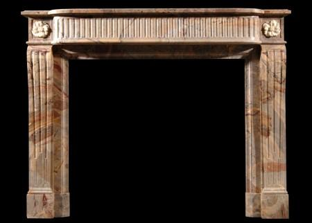 A FRENCH LOUIS XVI STYLE SARRANCOLIN MARBLE FIREPLACE