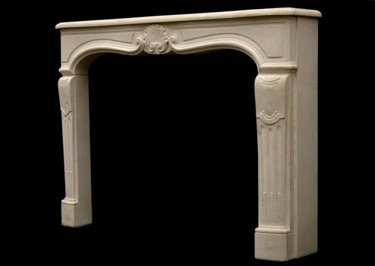 A 20TH CENTURY LOUIS XV STYLE LIMESTONE FIREPLACE-Detail3