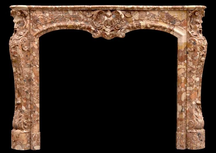 An unusual French transitional style Breche d'Alep marble fireplace