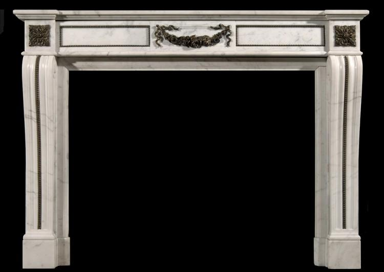 A Louis XVI style Statuary chimneypiece with brass ormolu embellisments