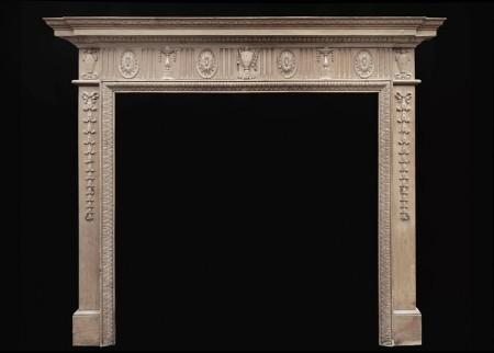 AN CLASSICAL ENGLISH WAXED PINE FIREPLACE