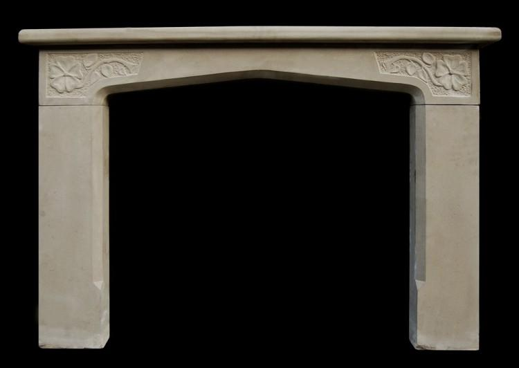 A 20th century limestone English fireplace in the Tudor manner