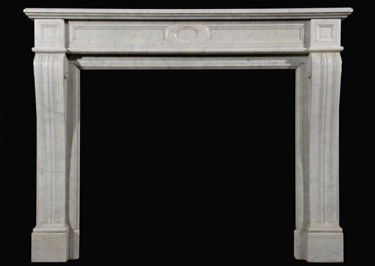 A neo classical 19th century French Carrara marble fireplace