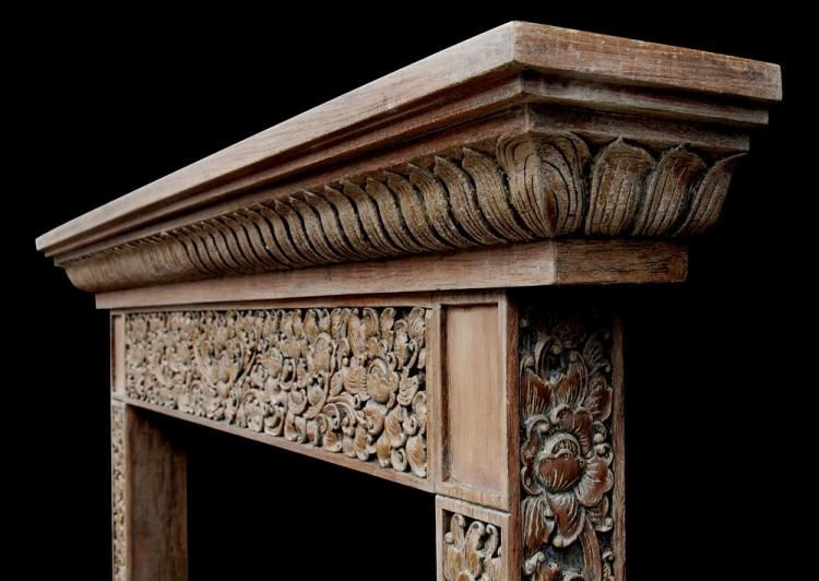 A HEAVILY CARVED HARDWOOD FIREPLACE WITH AN ORIENTAL INFLUENCE-Detail2