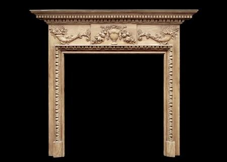 A ENGLISH GEORGIAN STYLE PINE FIREPLACE WITH GESSO ENRICHMENTS