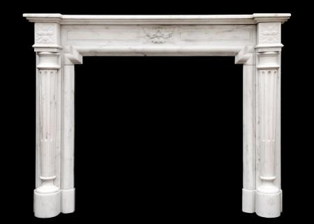 AN FRENCH LOUIS XVI STYLE FIREPLACE IN STATUARY MARBLE