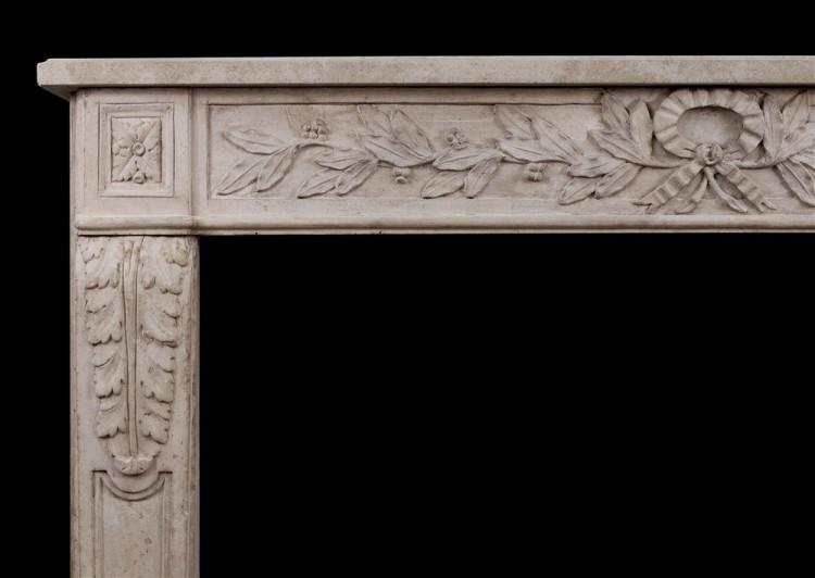 AN ORNATELY CARVED FRENCH LIMESTONE FIREPLACE IN THE LOUIS XVI STYLE-Detail1