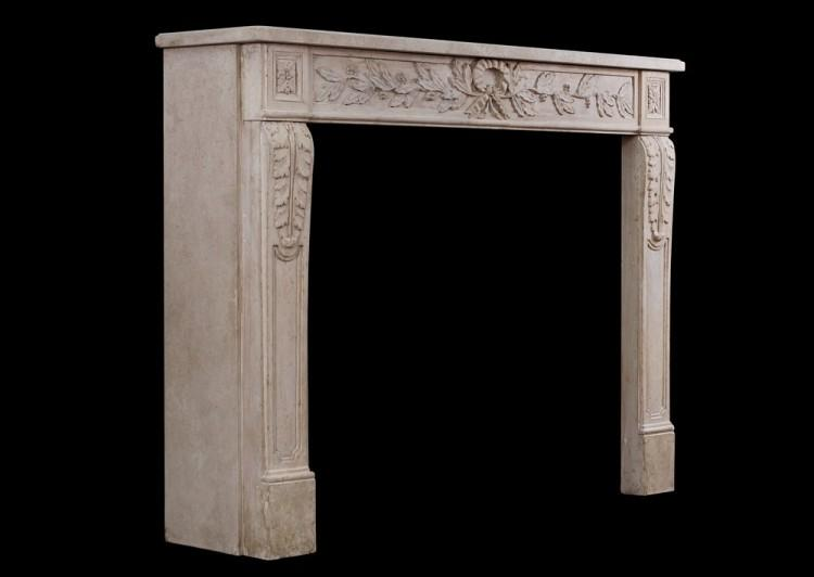 AN ORNATELY CARVED FRENCH LIMESTONE FIREPLACE IN THE LOUIS XVI STYLE-Detail4