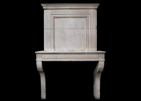 A LATE 18TH CENTURY FRENCH LOUIS XVI LIMESTONE FIREPLACE WITH TRUMEAU