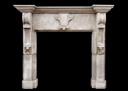 A LARGE ENGLISH LIMESTONE FIREPLACE WITH SHAPED BRACKETS
