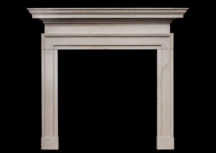 A George II style Ancaster stone fireplace