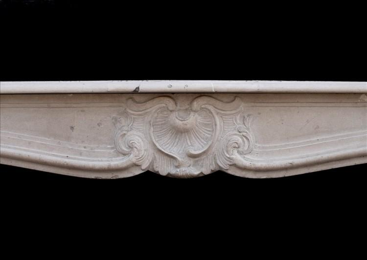 A 19TH CENTURY FRENCH LOUIS XV STYLE LIMESTONE FIREPLACE-Detail1