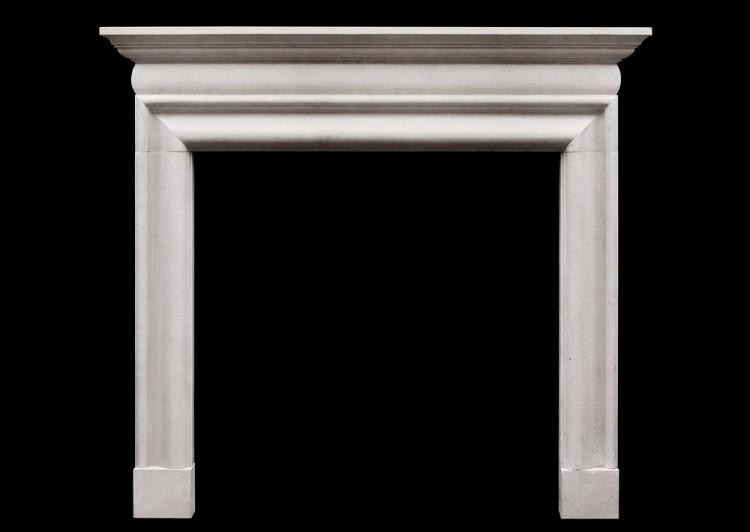 An early Georgian style Portland stone fireplace