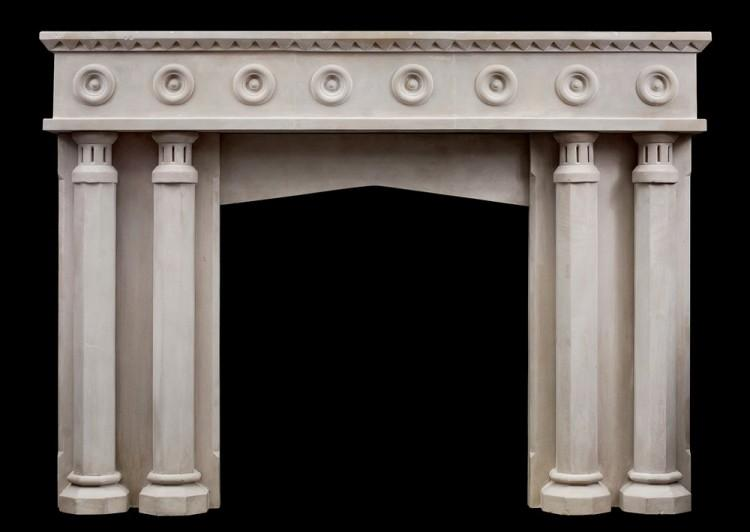 An English limestone fireplace with a gothic influence