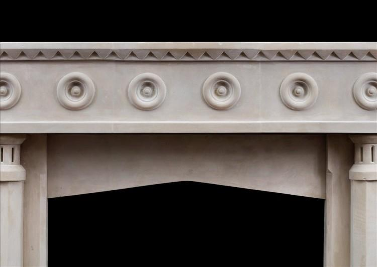 AN ENGLISH LIMESTONE FIREPLACE WITH A GOTHIC INFLUENCE-Detail1