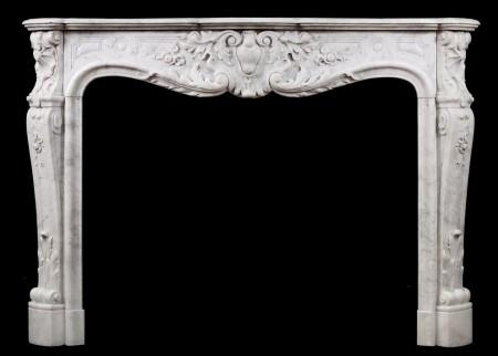 A FINE QUALITY CARVED FRENCH LOUIS XV CARRARA FIREPLACE