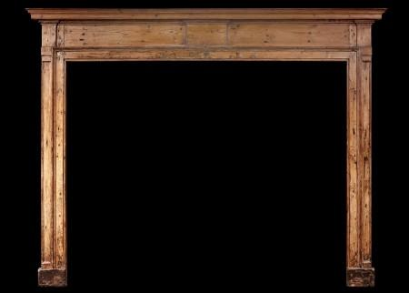 A LARGE EARLY 18TH CENTURY ENGLISH PINE FIREPLACE