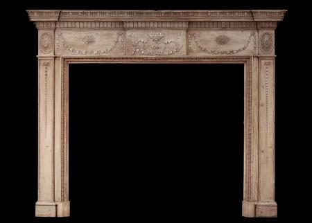 AN 18TH CENTURY PINE AND GESSO FIREPLACE