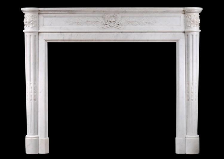 A 19th century French Louis XVI style mantel piece in light Carrara marble