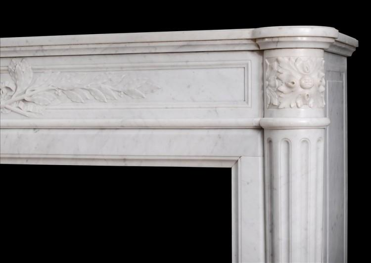 A 19TH CENTURY FRENCH LOUIS XVI STYLE MANTEL PIECE IN LIGHT CARRARA MARBLE-Detail2