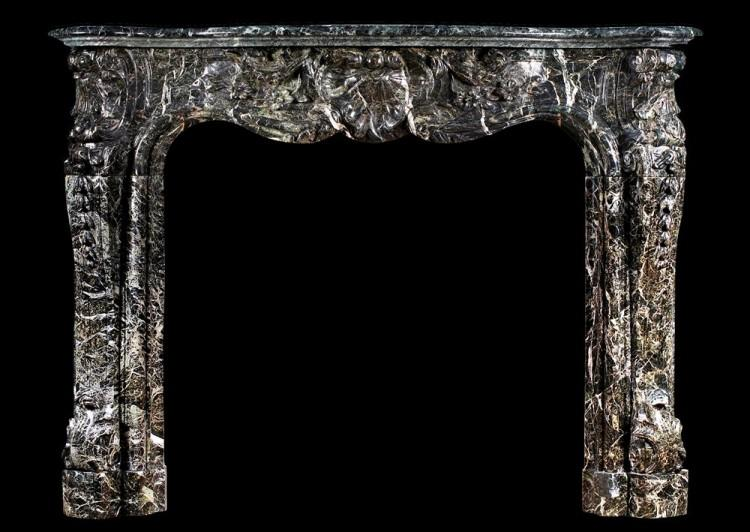 A 19th century French Louis XV style fireplace in Tinos green marble