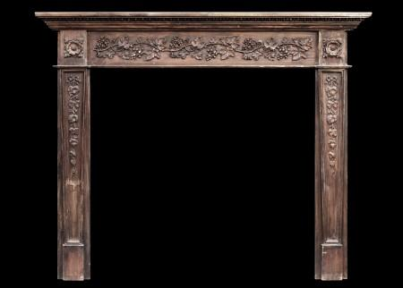 AN ENGLISH REGENCY STYLE PINE FIREPLACE WITH GESSO DETAILING