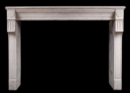 A RUSTIC 18TH CENTURY FRENCH LOUIS XVI LIMESTONE FIREPLACE