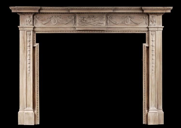 A large English wood fireplace in the Georgian style